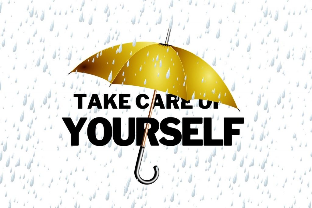 Gold Umbrella Over Black Text That Says Take Care of Yourself with Rain Falling